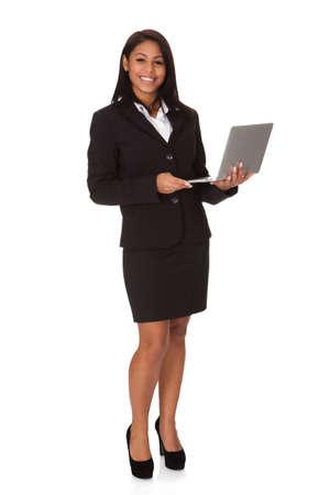 Businesswoman Holding Laptop. Isolated on white background Stock Photo - 17630192