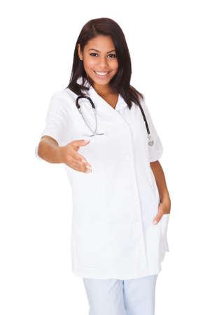 Female Doctor Extending Her Hand To Handshake. Isolated On White photo