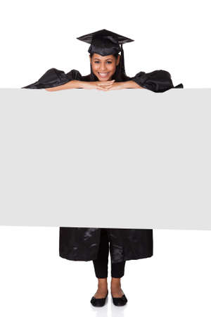 college graduation: Graduate Woman Holding Placard. Isolated On White Stock Photo
