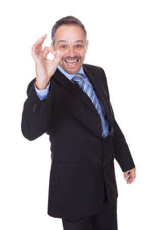 ok symbol: Happy Businessman With Thumbs Up Isolated On White Background