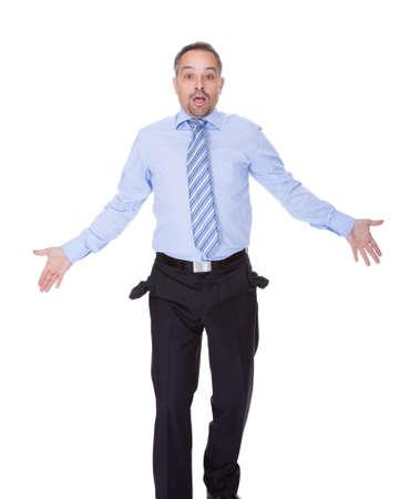 empty pockets: Businessman Showing Empty Pockets On White Backgrounds Stock Photo