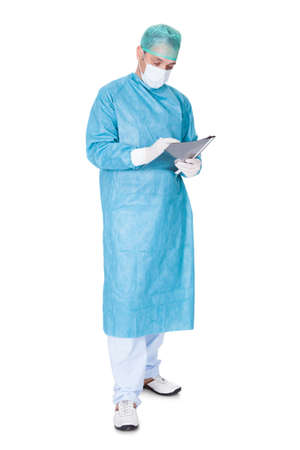 operation gown: Portrait Of Doctor In Operation Gown Writing On Folder Isolated On White Background