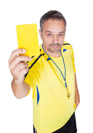 Soccer Referee Showing Yellow Card On White Background photo