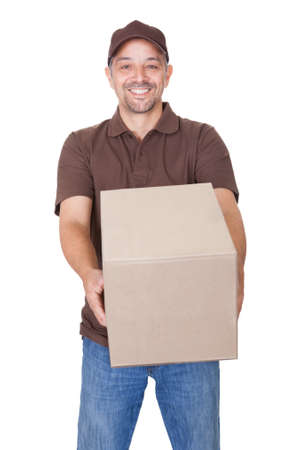 Happy Delivery Man Holding Cardbox Isolated On White Background photo