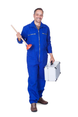 sewer pipe: Happy Plumber Holding Plunger On White Background Stock Photo
