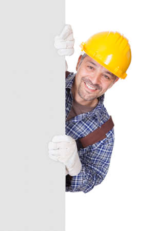 perforate: Portrait Of Happy Contractor Holding Placard On White Background Stock Photo