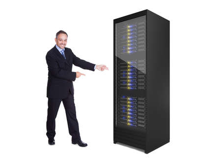 Businessman presenting server rack. Isolated on white Stock Photo - 17738960