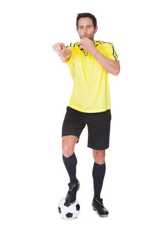 Soccer judge whistling. Isolated on white background Stock Photo - 17738562