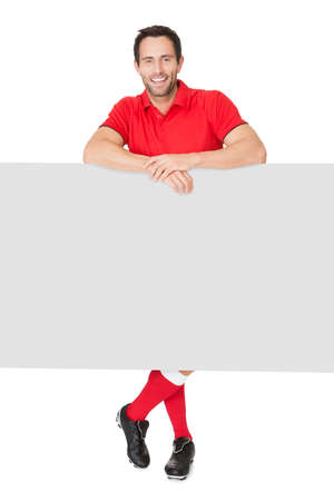 Portrait of soccer player presenting empty banner. Isolated on white Stock Photo - 17738611