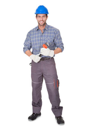 hard look: Portrait of happy worker. Isolated on white