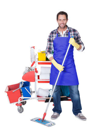 Man from professional cleaning service. Isolated on white photo
