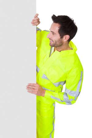 Happy worker wearing safety jacket. Isolated on white photo