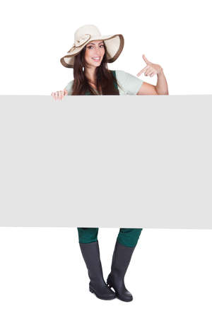 Pretty Woman Holding Blank Placard. Isolated On White Stock Photo - 17738694