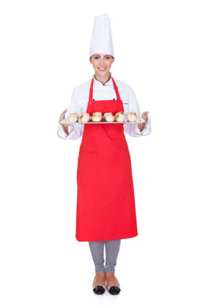 female chef: Female Baker Holding Fresh Bread. Isolated On White Stock Photo