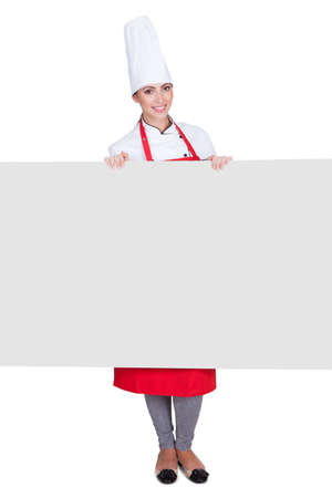 Happy Female Chef Holding Placard. Isolated On White photo