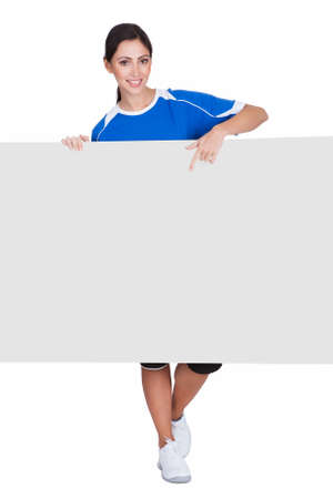 athletic wear: Sporty Woman Holding Blank Placard. Isolated On White