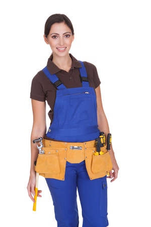 tool belt: Female Construction Worker With Toolbelt. Isolated On White Stock Photo