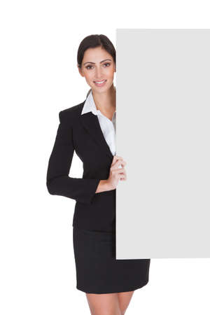 Happy Smiling Young Business Woman Holding Blank Placard. Isolated On White Stock Photo - 17738884