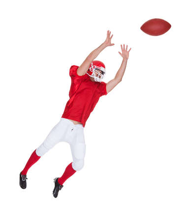 American Football player catching ball. Isolated on white photo