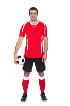 uniforme de futbol: Retrato del jugador profesional de f�tbol. Aislados en blanco Foto de archivo