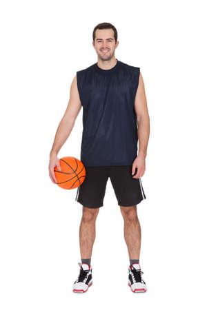 canestro basket: Ritratto del giocatore di basket professionista. Isolati su bianco Archivio Fotografico
