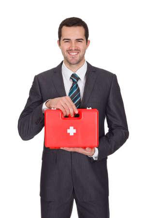first aid kit: Empresaria feliz con caja de primeros auxilios. Aislado En Blanco