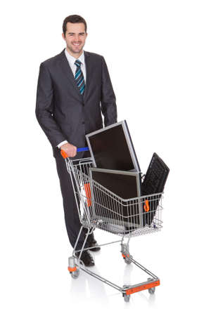 supermarket cart: Cheerful Businessman Shopping Lcd Monitors. Isolated On White