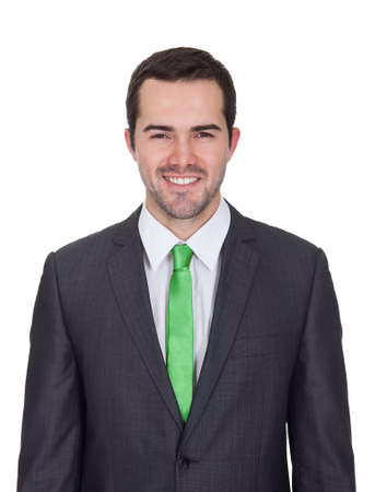 Businessman wearing green tie. Green business concept. Isolated on white Stock Photo - 17738986
