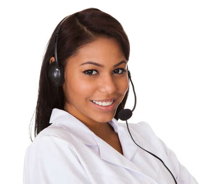 receptionists: Happy Woman Wearing Headset. Isolated On White Stock Photo