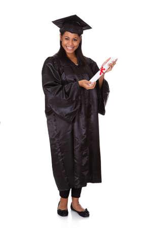 graduacion de universidad: Woman Holding Graduate Certificate. Aislado En Blanco