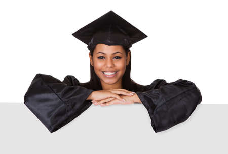education success: Graduate Woman Holding Placard. Isolated On White Stock Photo