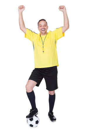 Portrait Of A Happy Soccer Player With A Football Against White Background photo