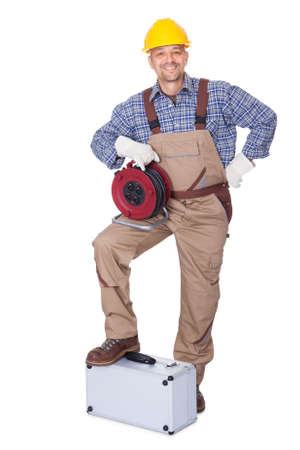 Happy Construction Worker Holding Toolbox And Cable On White Background Stock Photo - 17825781