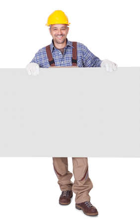 constructors: Portrait Of Happy Contractor Holding Placard On White Background Stock Photo