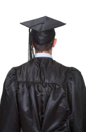 black  cap: Portrait of happy graduate student. Isolated on white