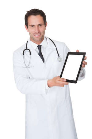 Portrait of friendly doctor presenting empty digital tablet screen. Isolated on white photo