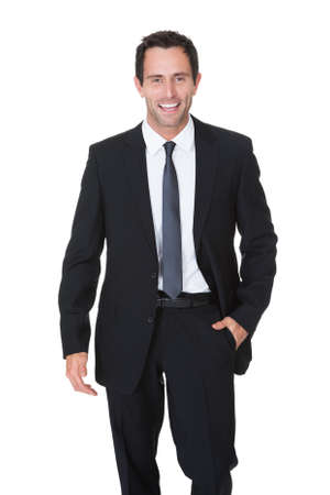 Portrait of happy middle aged businessman. Isolated on white
