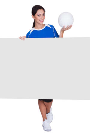Sporty Woman Holding Blank Placard. Isolated On White Stock Photo - 17826265