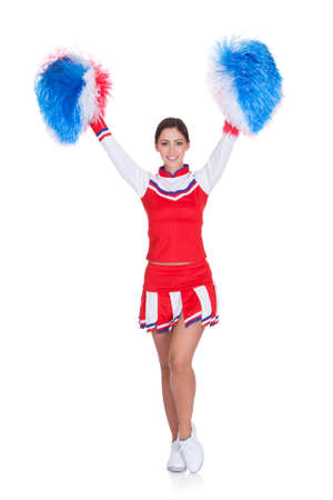 sexy school girl: Happy Smiling Cheerleader. Isolated On White Background Stock Photo