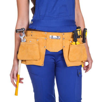 tools belt: Female Construction Worker With Toolbelt. Isolated On White Stock Photo