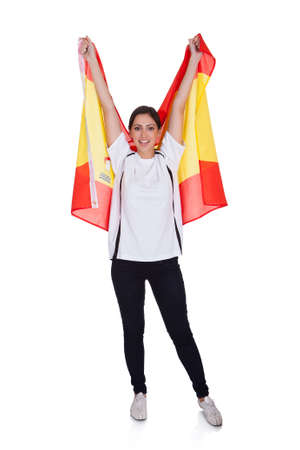 Portrait Of A Happy Pretty Woman Holding Spanish Flag. Isolated On White photo