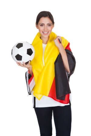 german girl: Portrait Of Happy Female German Supporter With Ball. Isolated On White