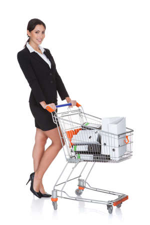 Attractive Businesswoman With Shopping Cart. Isolated On White photo