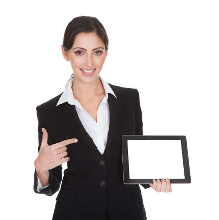 Smiling Businesswoman Holding Digital Tablet. Isolated On White photo