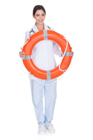 Smiling Female Doctor Holding Inflatable Ring. Isolated On White photo