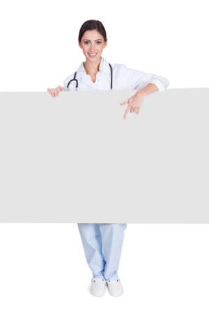 Happy Female Doctor Holding Placard. Isolated On White