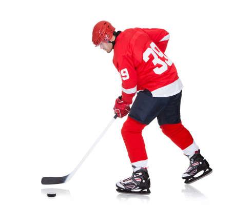 hockey ice: Professional hockey player skating on ice. Isolated on white