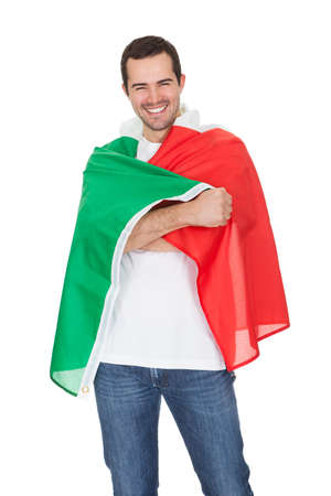 Portrait Of A Happy Man Holding An Italian Flag. Isolated on white photo