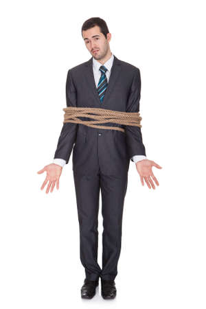 tied up: Businessman tied up in rope. Isolated on white Stock Photo
