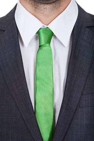 Businessman wearing green tie. Green business concept. Isolated on white Stock Photo - 17825719